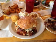 Brisket sandwich with cheese and carmelized onions (cornbread, great slaw and Mac/Cheese sides)